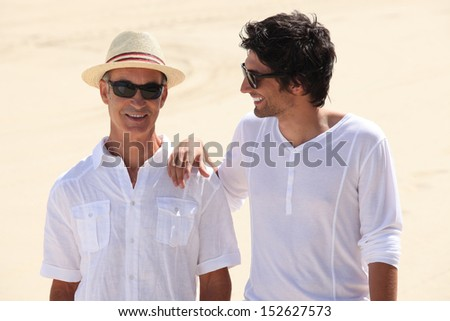 Grandfather with grandson walking - stock photo