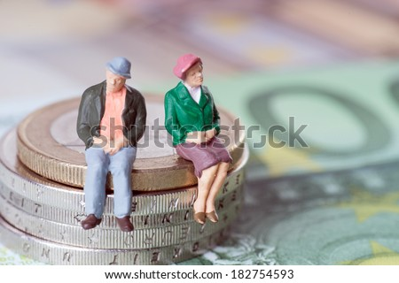 Grandma and Grandpa on a stack of euro coins / Grandma and Grandpa - stock photo