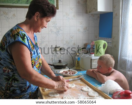 grandmother and grandchild cooking - stock photo