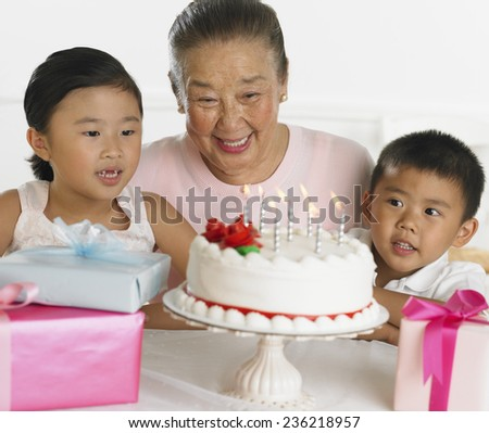 Grandmother and Grandchildren at Birthday Party - stock photo