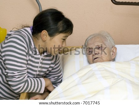 Grandmother and granddaughter at a nursing home. - stock photo