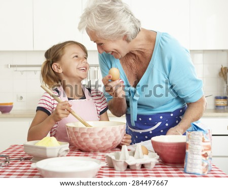 Grandmother And Granddaughter Baking In Kitchen - stock photo