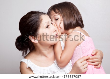 Grandmother and granddaughter gossiping - stock photo