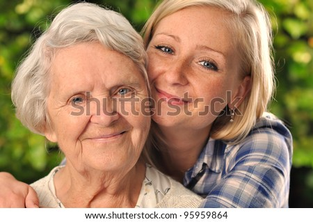 Grandmother and granddaughter. MANY OTHER PHOTOS WITH THIS SENIOR MODEL IN MY PORTFOLIO. - stock photo