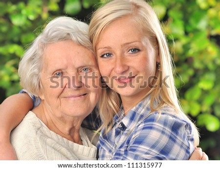 Grandmother and granddaughter. MANY OTHER PHOTOS WITH THIS SENIOR WOMAN IN MY PORTFOLIO. - stock photo