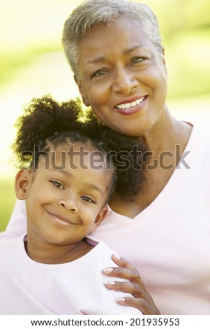 Grandmother and granddaughter portrait - stock photo