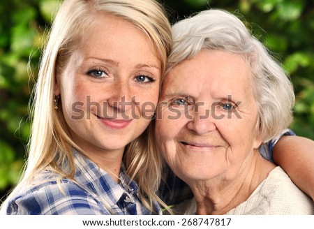 Grandmother and granddaughter. Young woman takes care of an elderly woman. MANY OTHER PHOTOS FROM THIS SERIES IN MY PORTFOLIO.  - stock photo