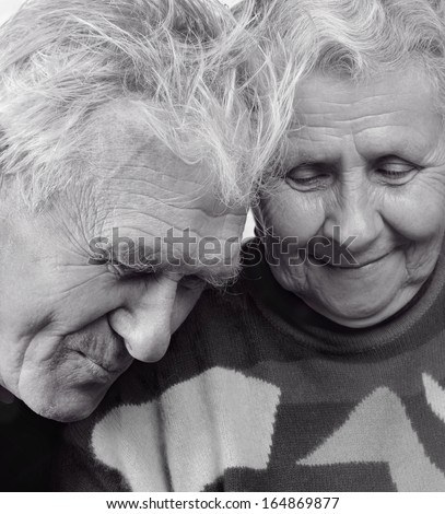 Grandmother and grandfather. A loving, handsome senior couple. - stock photo