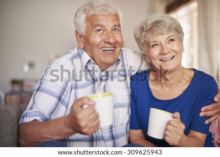 Grandmother and grandfather drinking after dinner tea