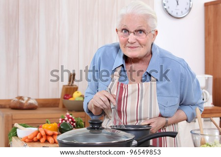 grandmother cooking - stock photo