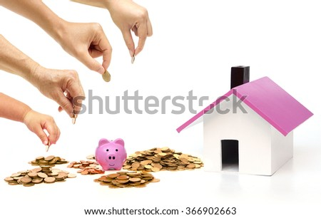 Grandmother, father, mother, and baby in the family do saving money in pink piggy banks for buying a house - stock photo