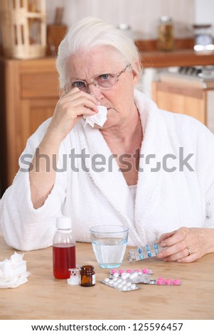 grandmother having a cold - stock photo