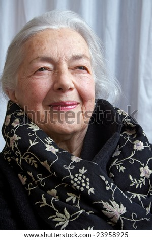 Grandmother portrait with elegant scarf - stock photo