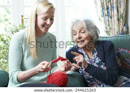 Grandmother Showing Granddaughter How To Knit - stock photo