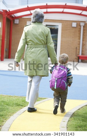 Grandmother Taking Grandson To School - stock photo