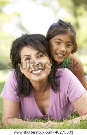 Grandmother With Granddaughter In Park - stock photo