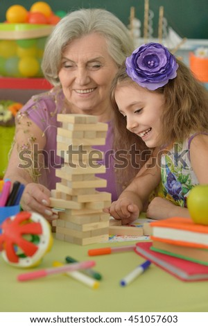 Grandmother with granddaughter playing together - stock photo