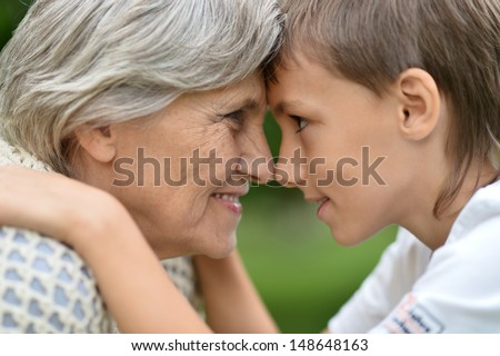 grandmother with her grandson in an outdoor - stock photo