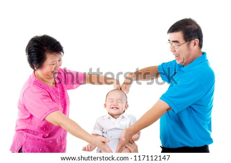 grandparent playing with their grandson - stock photo