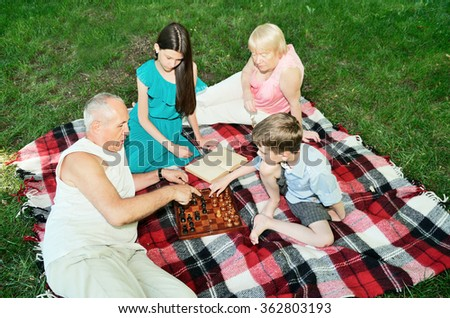 grandparents and grandchildren are resting in the park. top view. horizontal - stock photo