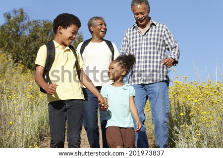 Grandparents and grandchildren on country hike - stock photo