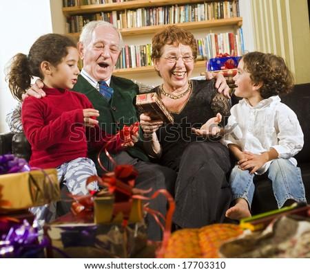 grandparents, grandchildren and presents - stock photo