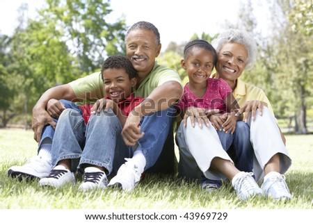 Grandparents In Park With Grandchildren - stock photo
