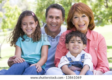 Grandparents posing with grandchildren - stock photo
