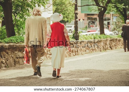 Grandparents walking - stock photo