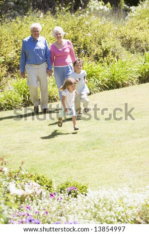 Grandparents walking with grandchildren - stock photo
