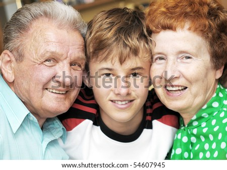 Grandparents with grandson embracing together portrait - stock photo
