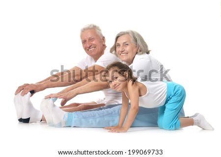 Grandparents with little girl Exercising On White Background - stock photo
