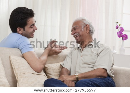 Grandson and grandfather talking - stock photo