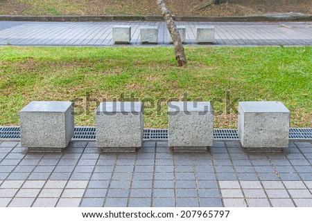 Granite bench in the garden - stock photo