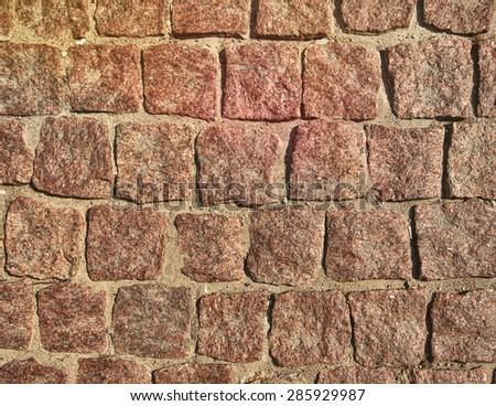 Granite cobble stoned pavement background - stock photo
