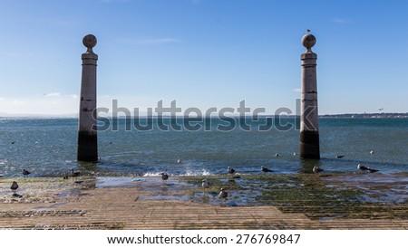 Granite columns in the Plaza del Comercio Lisbon - stock photo