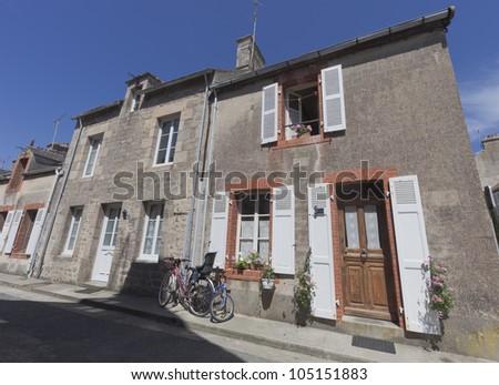 Granite houses in France - Barfleur, Basse Normandy, France - stock photo