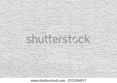 Granite rock stone tile wall aged texture detailed pattern background in light white gray color tone: Ancient rustic granite patterned backdrop for interior and architecture decoration  - stock photo