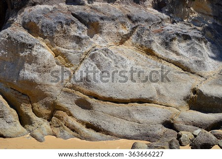 Granite rocks and golden sand background panorama. The rocks erode to form the famous Golden Bay gold coloured sands and are studded with sparkling quartz.  - stock photo