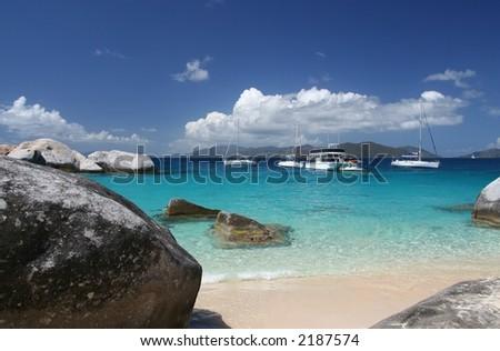 Granite rocks on a tropical beach - stock photo