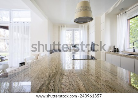 Granite worktop inside white light apartment - stock photo