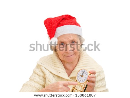 granny in red Santa Claus hat and clock, Snow Maiden - stock photo