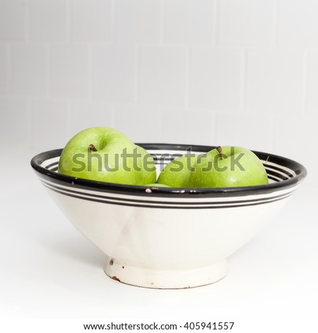 Granny Smith Apples in a bowl - stock photo