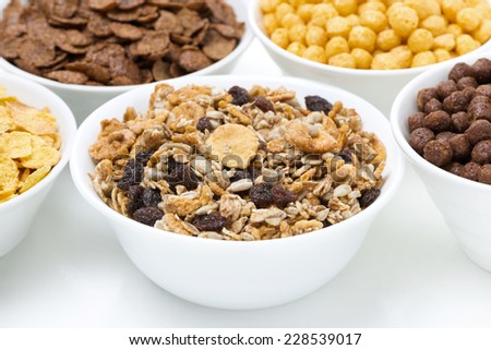 granola and various breakfast cereals, close-up - stock photo