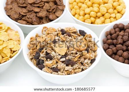 granola and various breakfast cereals, close-up, horizontal - stock photo