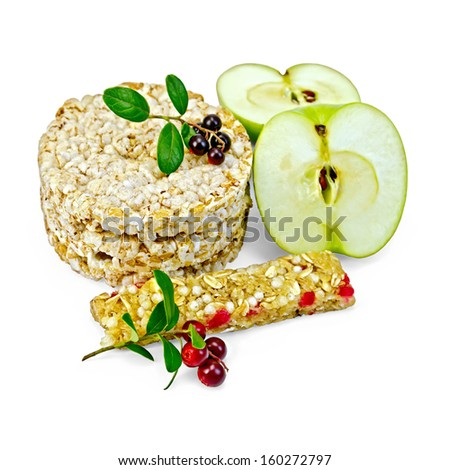 Granola bar, cereals stack crispbreads, sliced �¢??�¢??green apple, branches with leaves and berries lingonberries isolated on white background - stock photo