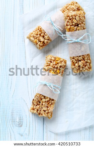 Granola bar on a blue wooden table - stock photo