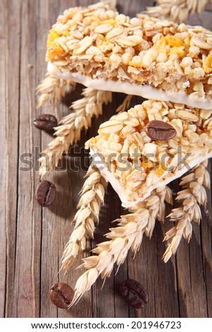 Granola bar on wooden background  - stock photo