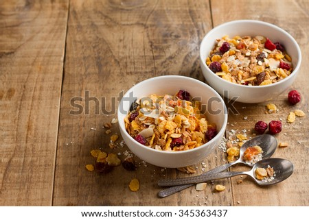 Granola or muesli and dried berries  for healthy morning meal, selective focus - stock photo