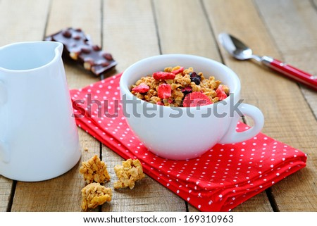 granola with dried fruit for breakfast, food closeup - stock photo